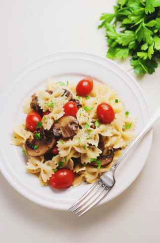 Easy Mushroom & Tomato Basil Bowtie Pasta - A tasty dinner that takes 15 minutes, filled with flavor, bursting tomatoes with cheesy pasta and mushrooms. Easy and my go-to for a quick dinner!