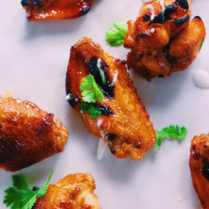 Zesty Honey Sriracha Chicken Wings - Perfect game night or throw together dinner if you're craving some sweet and spicy.