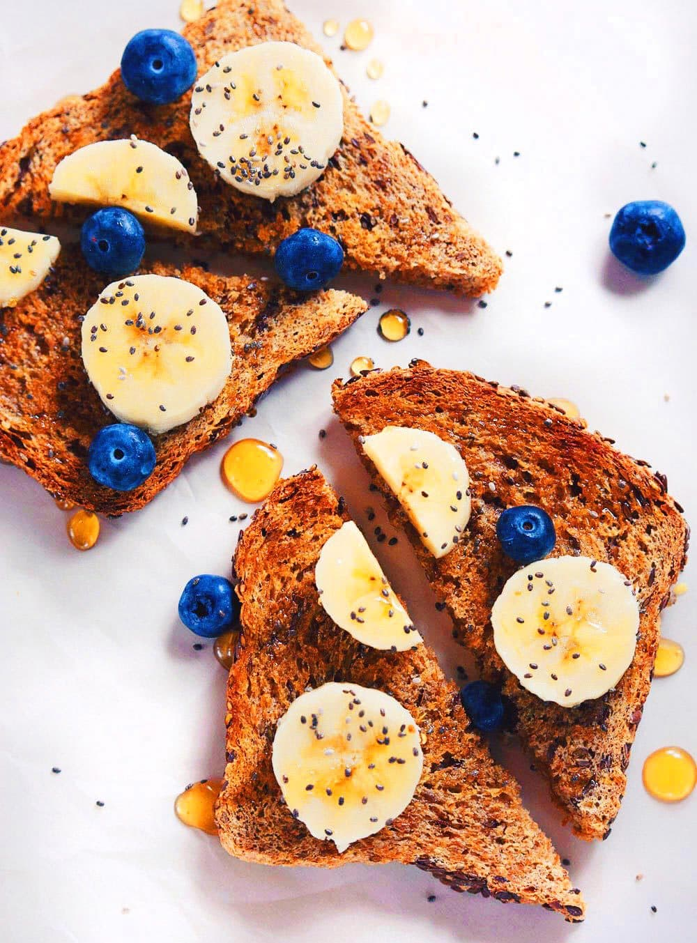 Coconut Oil Chia Toast with Fresh Fruit - My absolute favorite breakfast!A quick, wholesome way to eat a breakfast packed delicious fruit and healthy ingredients! SO yummy. | asimplepalate.com