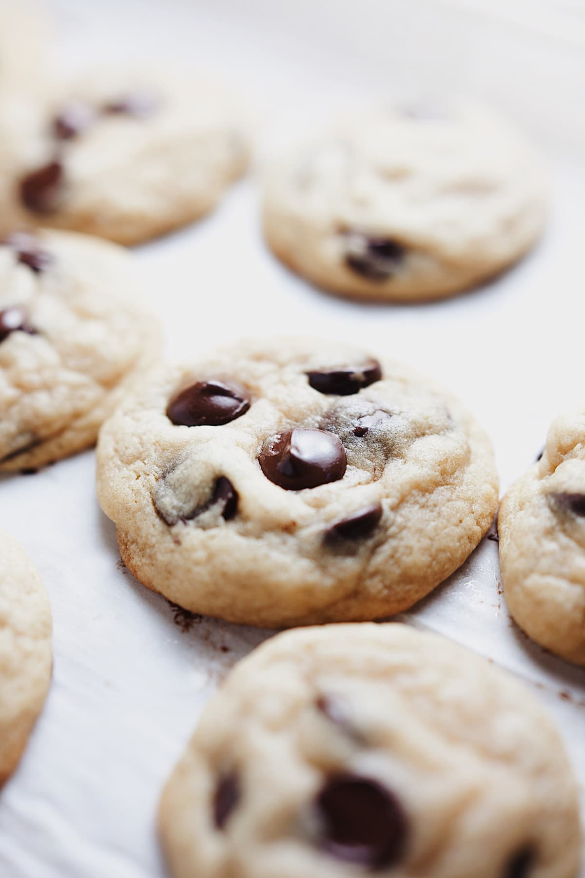 Chewy chocolate chip cookie recipe laid out on parchment paper.