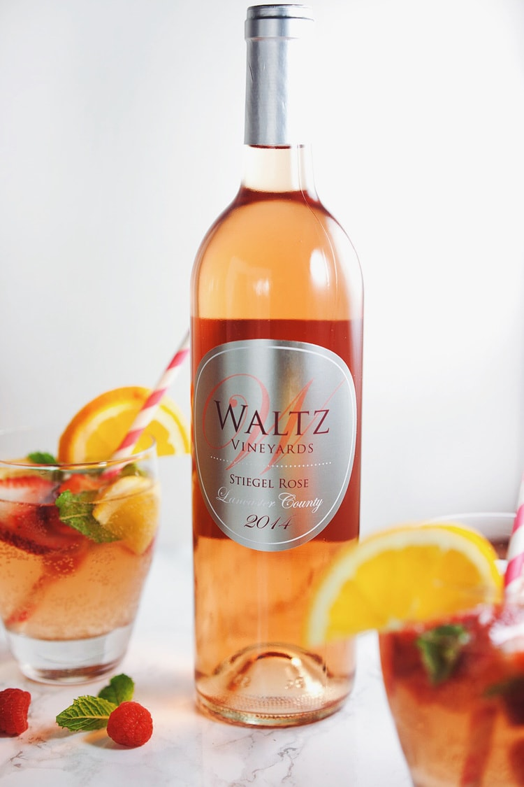 Fresh berries and citrus flavors all in a perfectly sweet, refreshing sangria! SO good. | asimplepalate.com