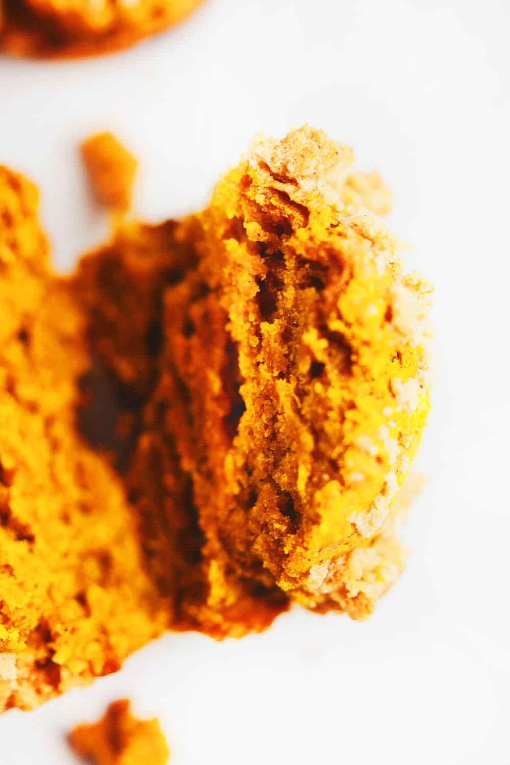 Fluffy Pumpkin Crumb Muffins - One of my favorite pumpkin recipes to make! Super flavorful, fluffy pumpkin muffins that are easy to make for any Holiday gathering! SOyummy. | asimplepalate.com