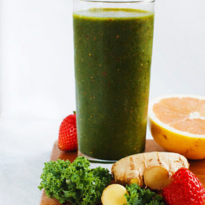 AMAZING green cleansing smoothie made with kale, fresh ginger, grape fruit, strawberries, and mangos. SO yum.   asimplepalate.com