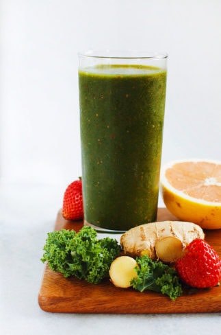 AMAZING green cleansing smoothie made with kale, fresh ginger, grape fruit, strawberries, and mangos. SO yum. | asimplepalate.com