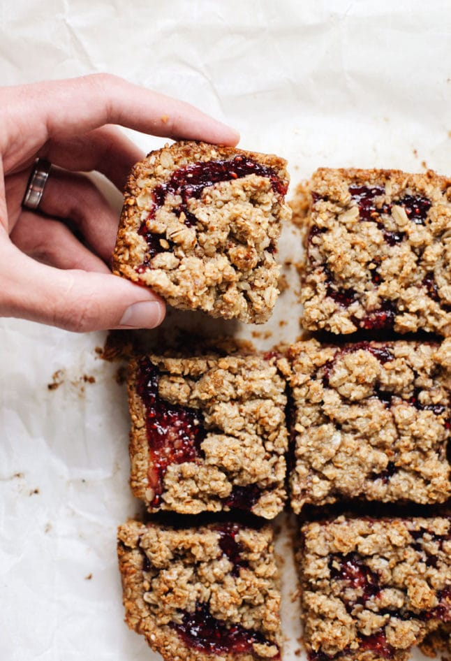 6 clean ingredients to make my FAVORITE jam bars! Consists of oat & almond flour, nut butter, and raspberry jam. SO yum!   asimplepalate.com