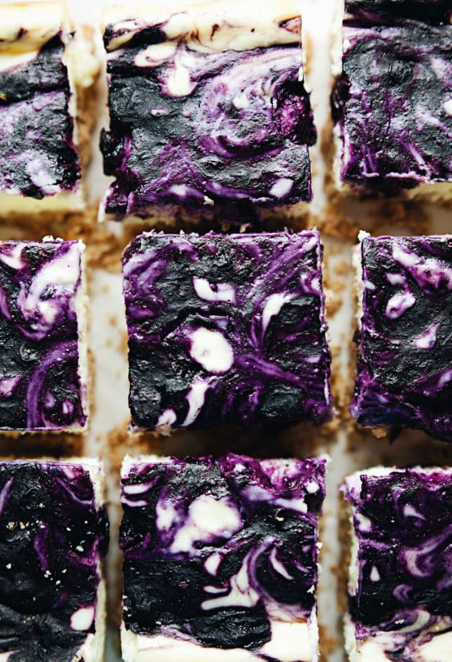 Creamy blueberry bars with an almond graham cracker crust! SO delicious.   asimplepalate.com