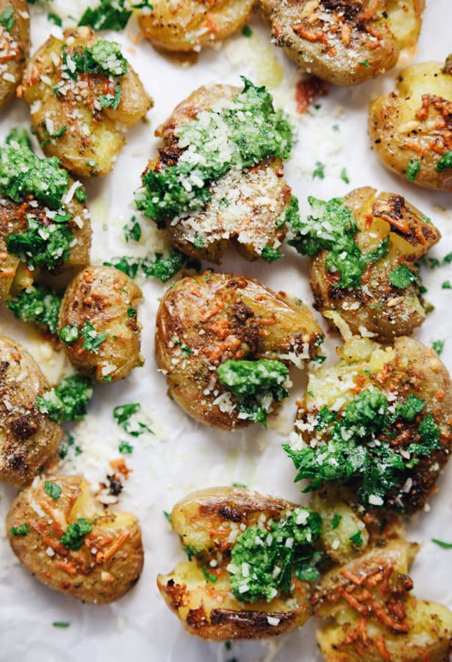 Garlic-y, smashed potatoes with parmesan cheese and refreshing pesto flavor! YUM.   asimplepalate.com