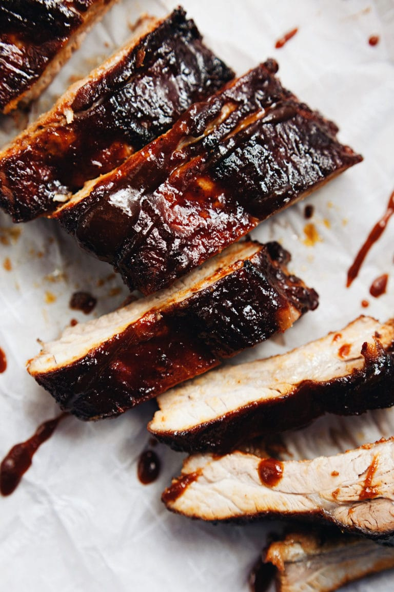 Sticky, smokey, best EVER barbecue ribs! Bake, brush with BBQ sauce, and ENJOY. | asimplepalate.com #ribs #bbqrecipe #grilling