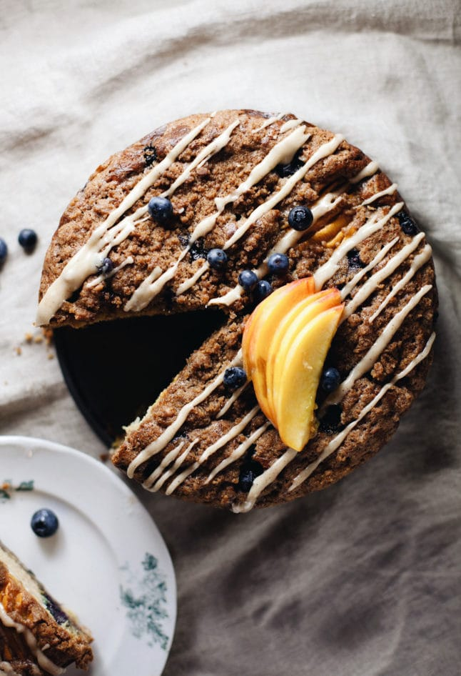 Super moist, mildly sweet, summer coffee cake with peaches and blueberries! AMAZING. | asimplepalate.com