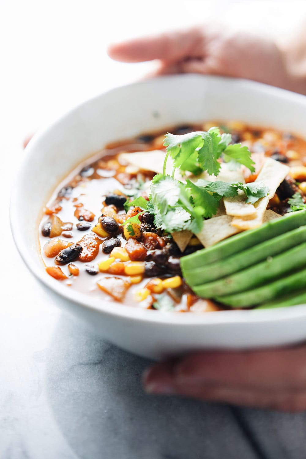 Healthy Vegetarian Tortilla Soup! Comforting flavors, SO yummy, and the perfect healthy one pot dinner! | asimplepalate.com #soup #healthy #dinner #healthydinner #plantbased #vegetarian #paleo