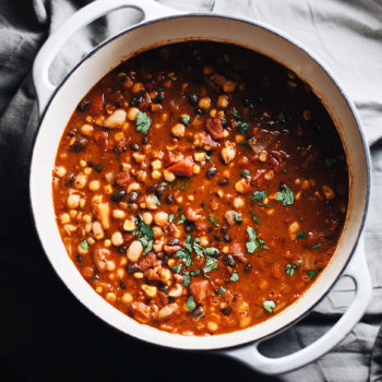 A white dutch oven with vegetarian bean chili.