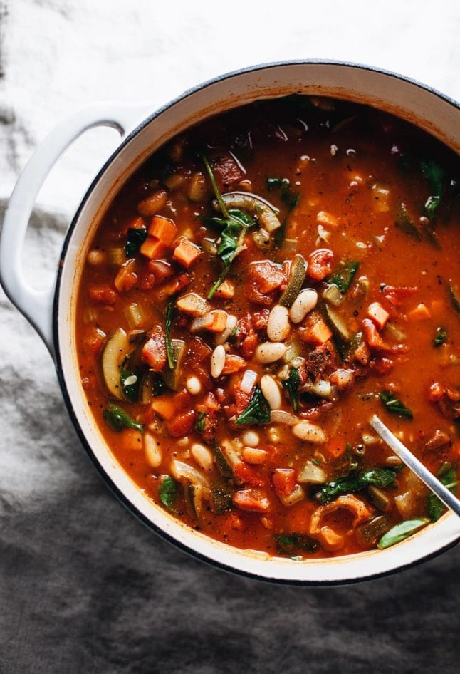 Bean soup in cast iron pot on marble countertop