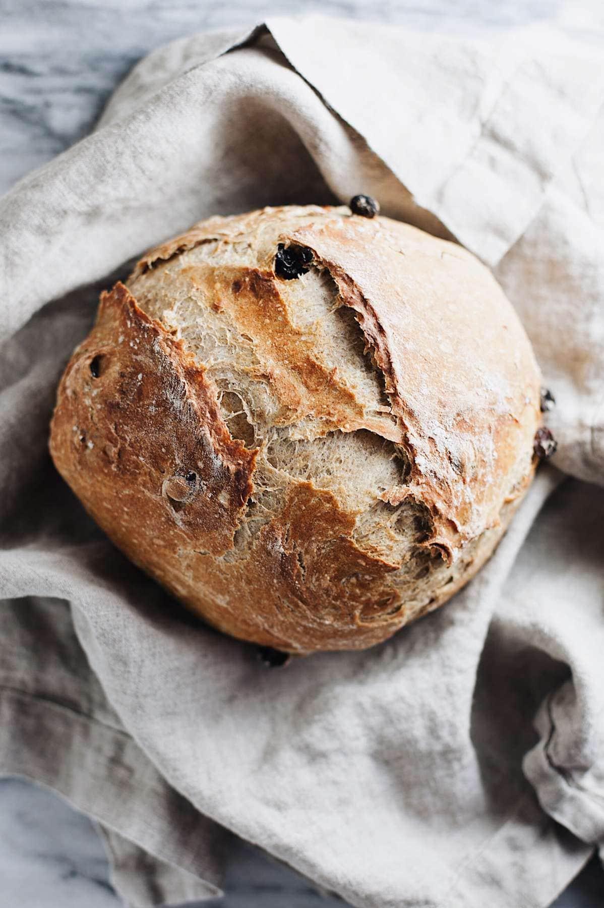 raisin bread recipe on a grey napkin