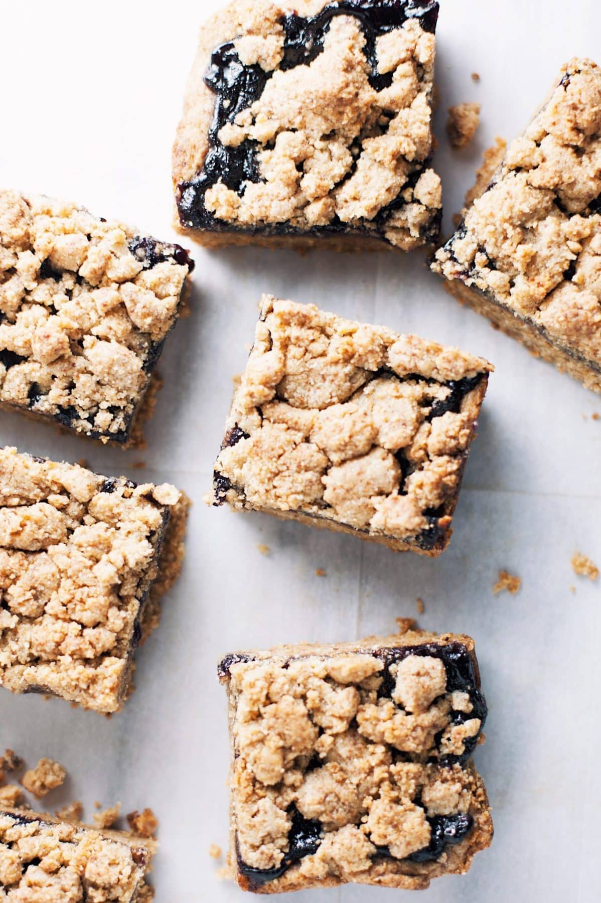 blueberry crumble bar on parchment papaer