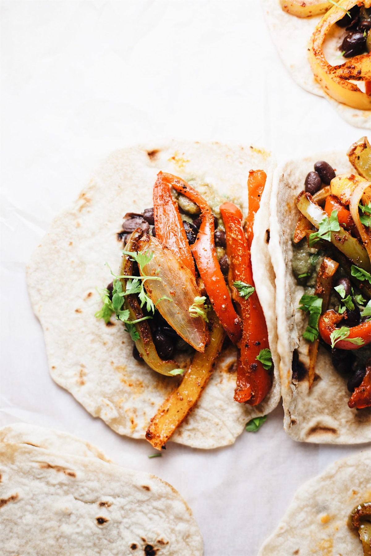 vegetarian fajitas with peppers, onions in a tortilla