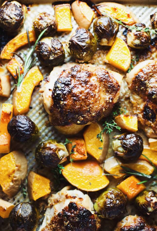 A chicken sheet pan dinner with roasted brussels sprouts and butternut squash.