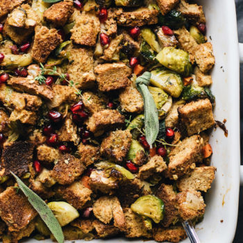 A close up of a white dish of Thanksgiving stuffing on a grey napkin