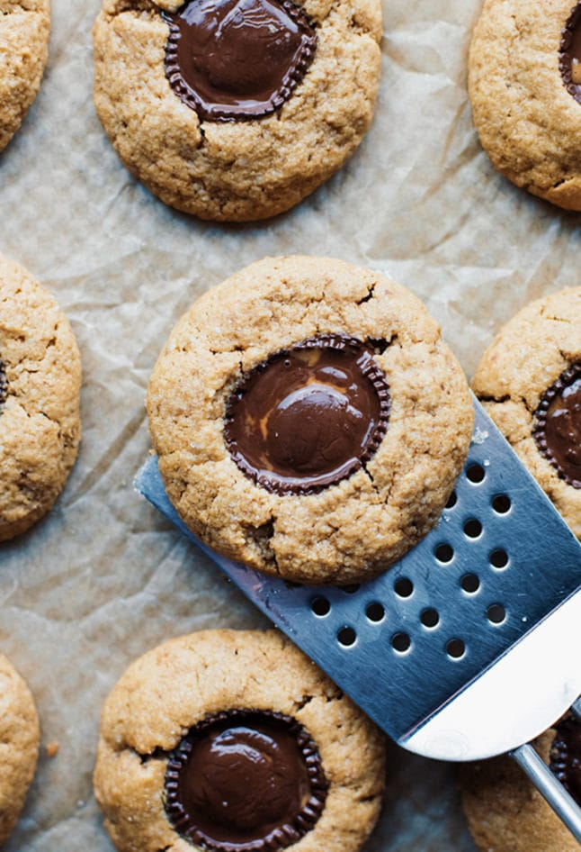 A spatula lifting up a peanut butter cup cookie.