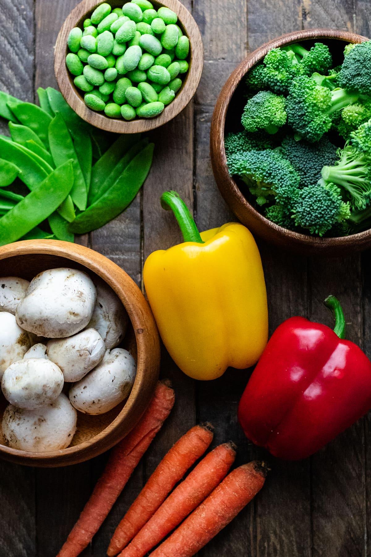 vegetables arranged on brown wooden board.