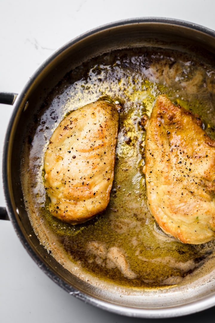 A pan on a white counter browned in butter.
