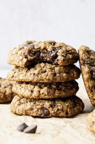a stack of oatmeal chocolate chip cookies on with a bite out of it.