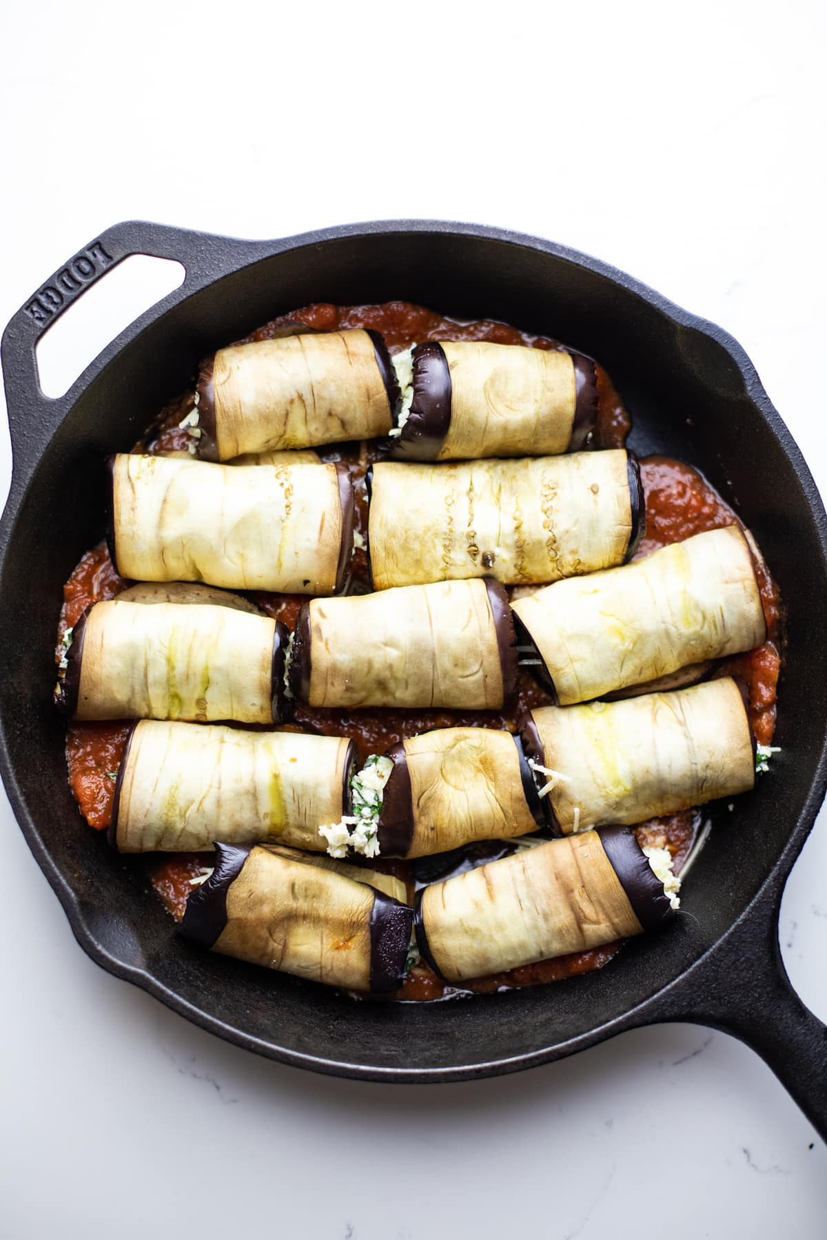 eggplant rollatini in a black cast iron skillet.