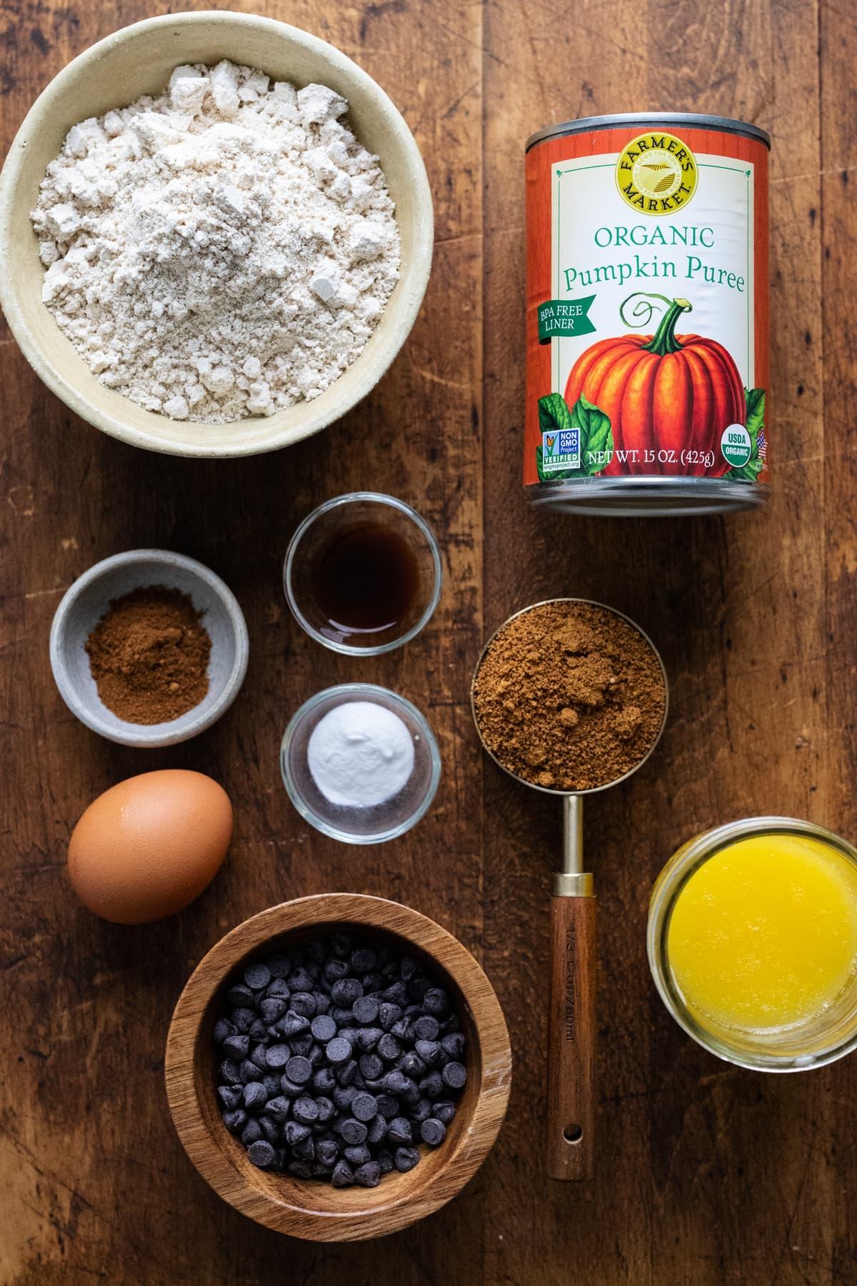 Ingredients for pumpkin blondies arranged on a wooden board.