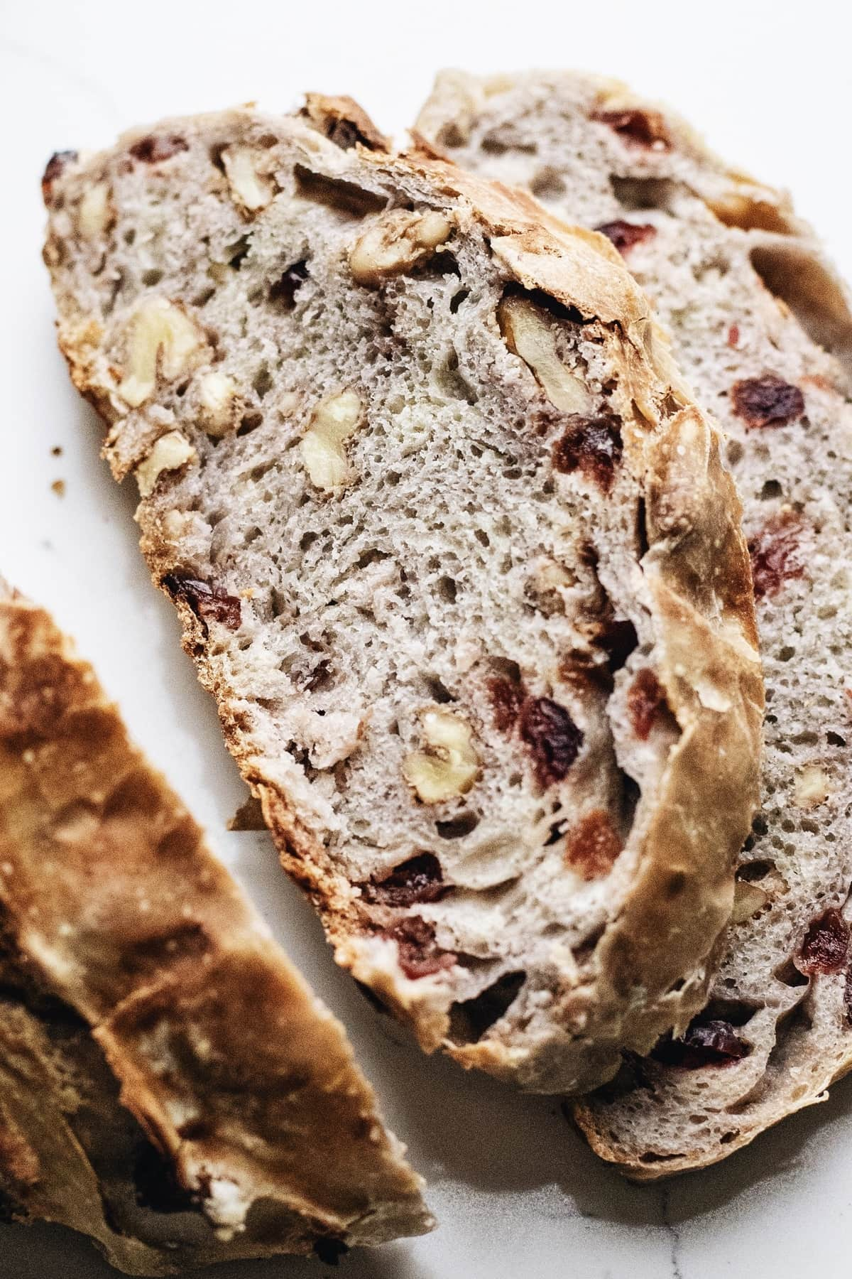 Slices of cranberry walnut bread.