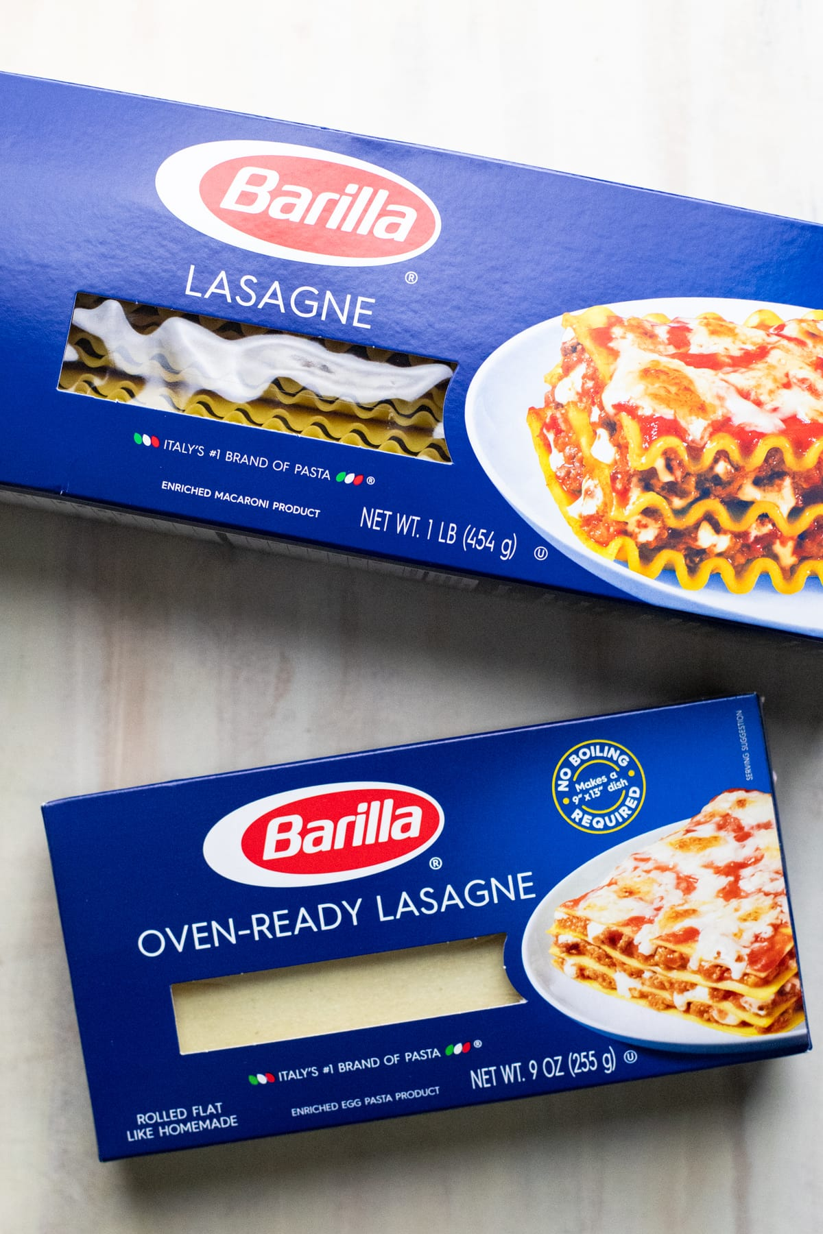 Blue boxes of lasagna noodle packages on white background.