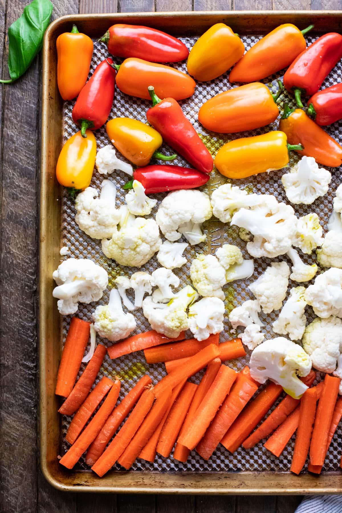 vegetables arranged on sheet pan.