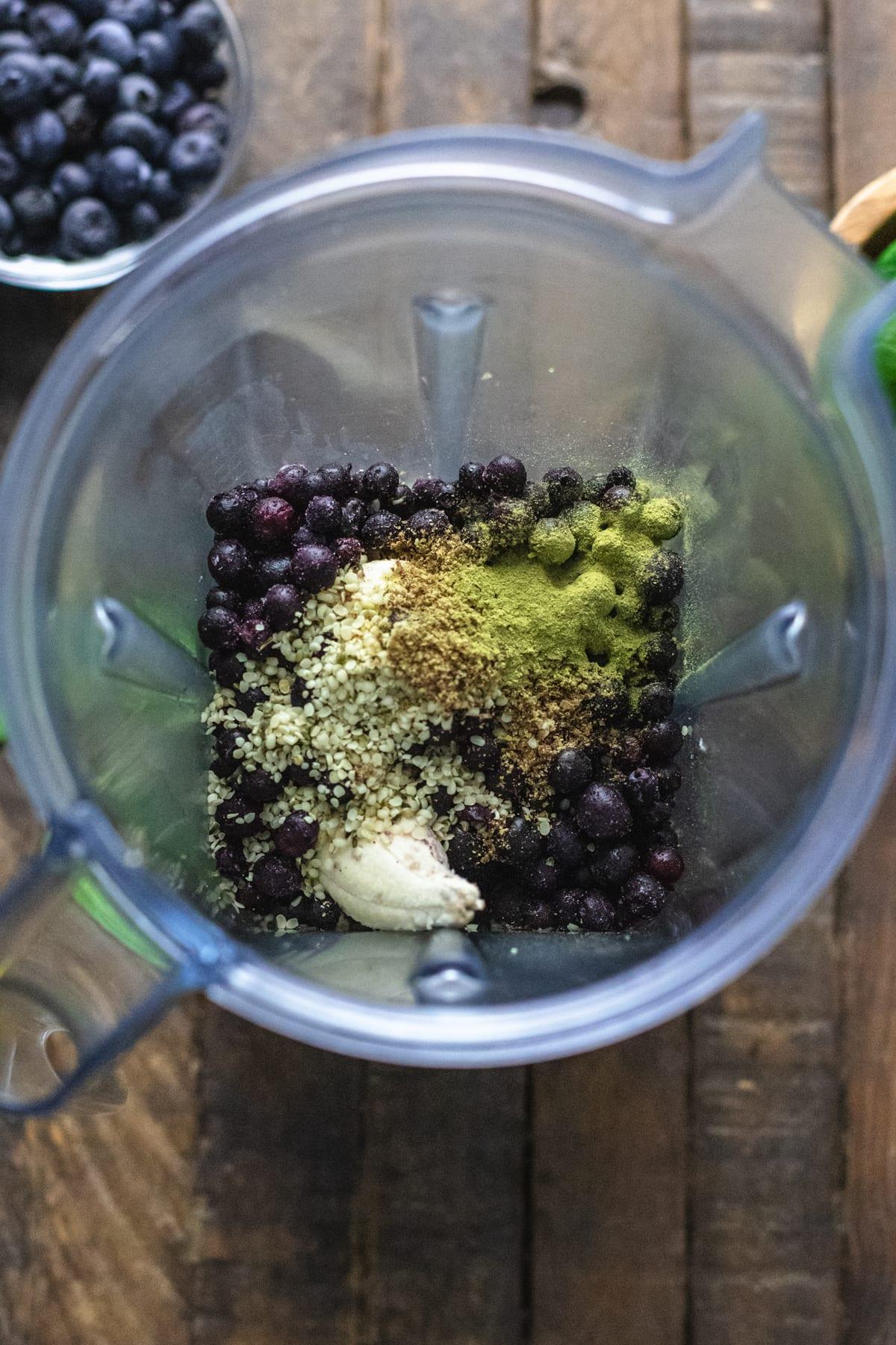 smoothie ingredients in a blender.