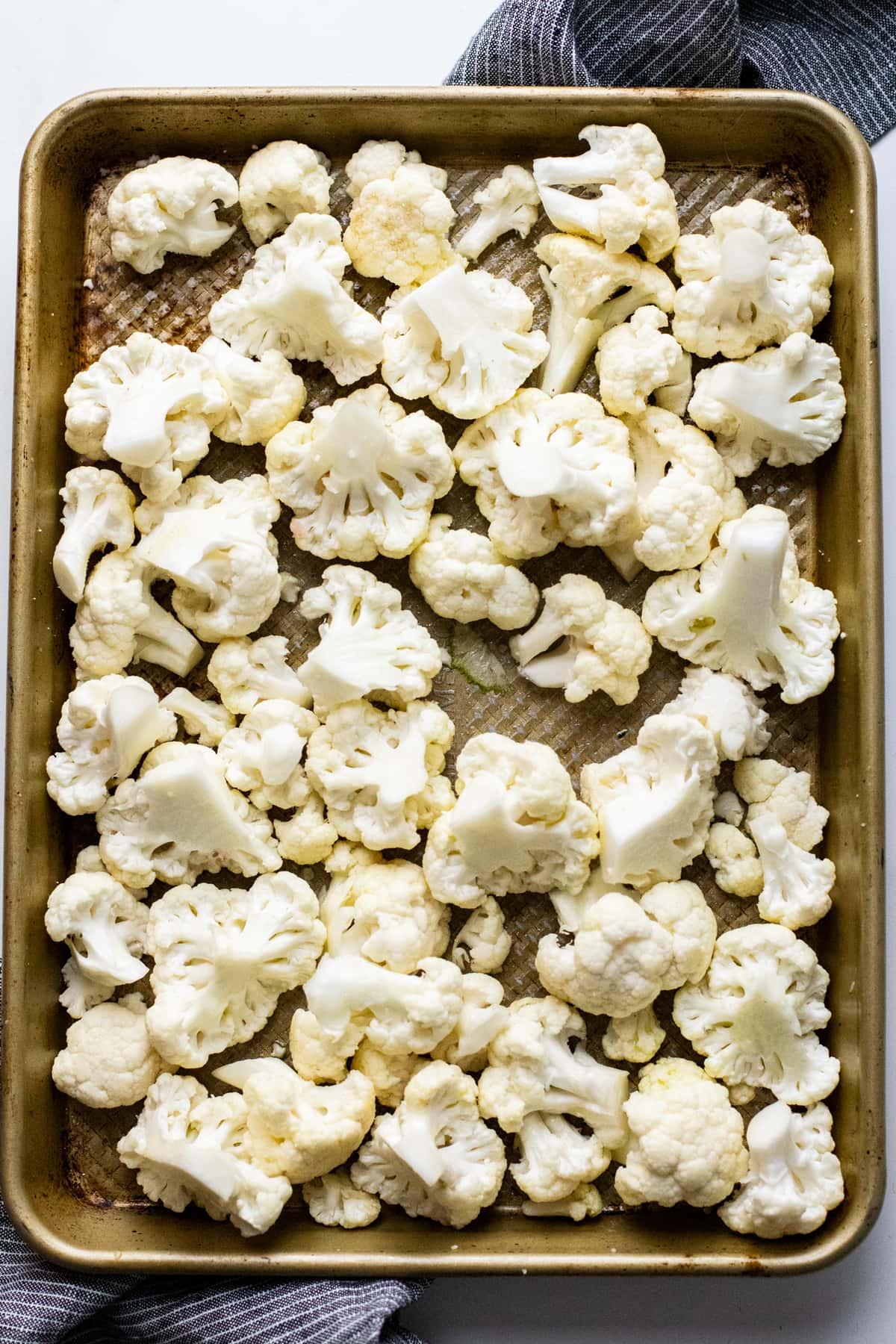 cauliflower florets on a sheet pan.