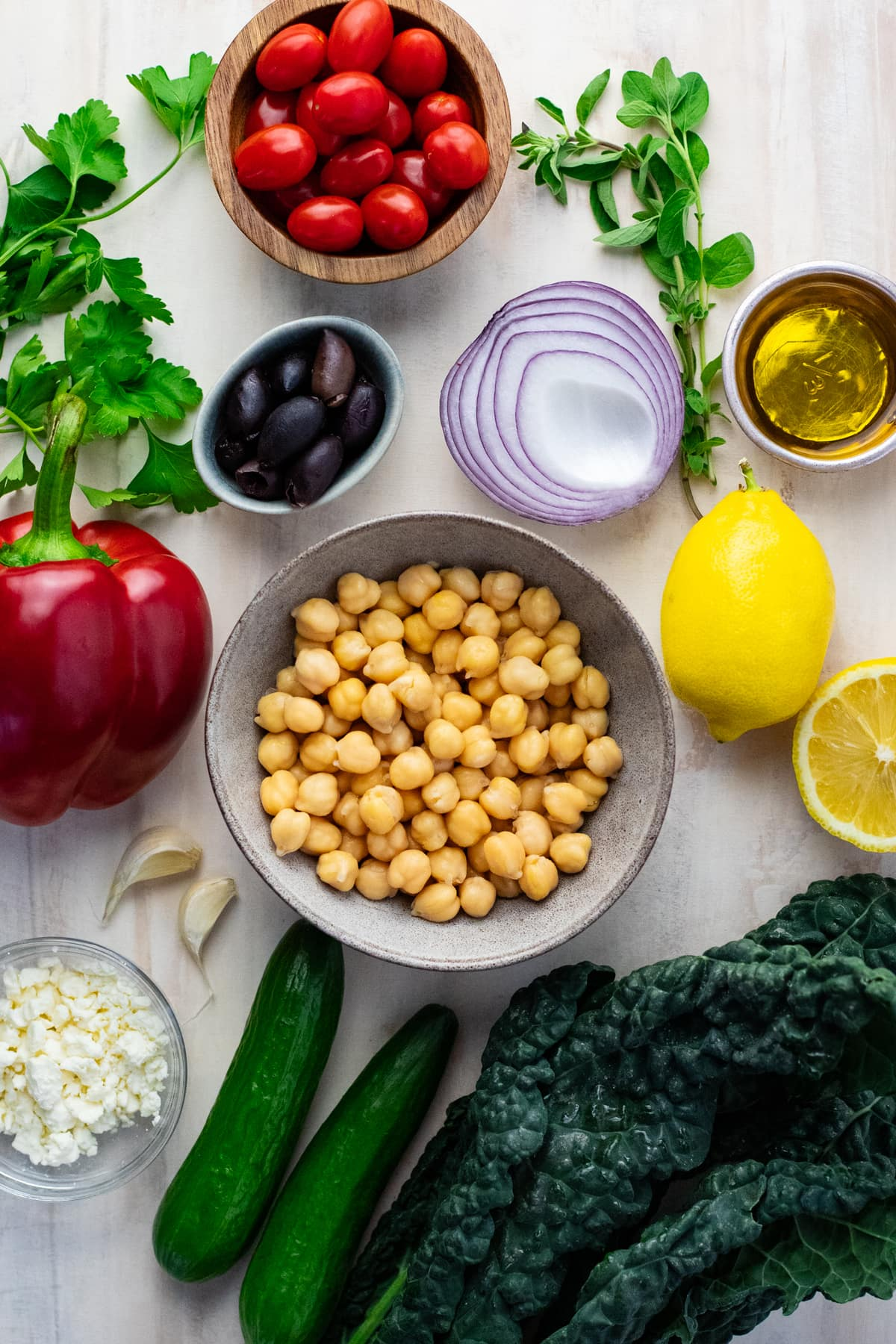 Ingredients for chickpea salad arranged on a light background.