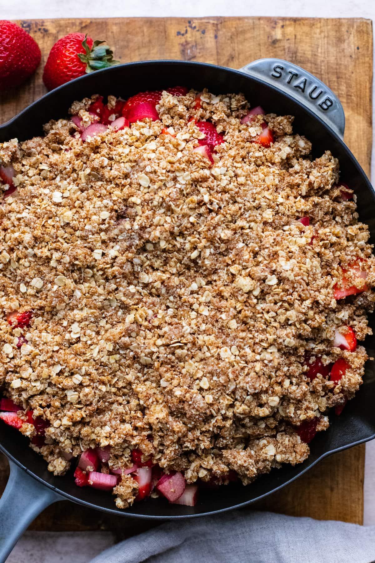 skillet pan with gluten free strawberry rhubarb crisp in it.