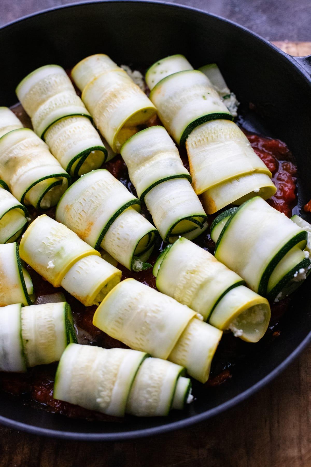 zucchini rollatini in black sikillet.