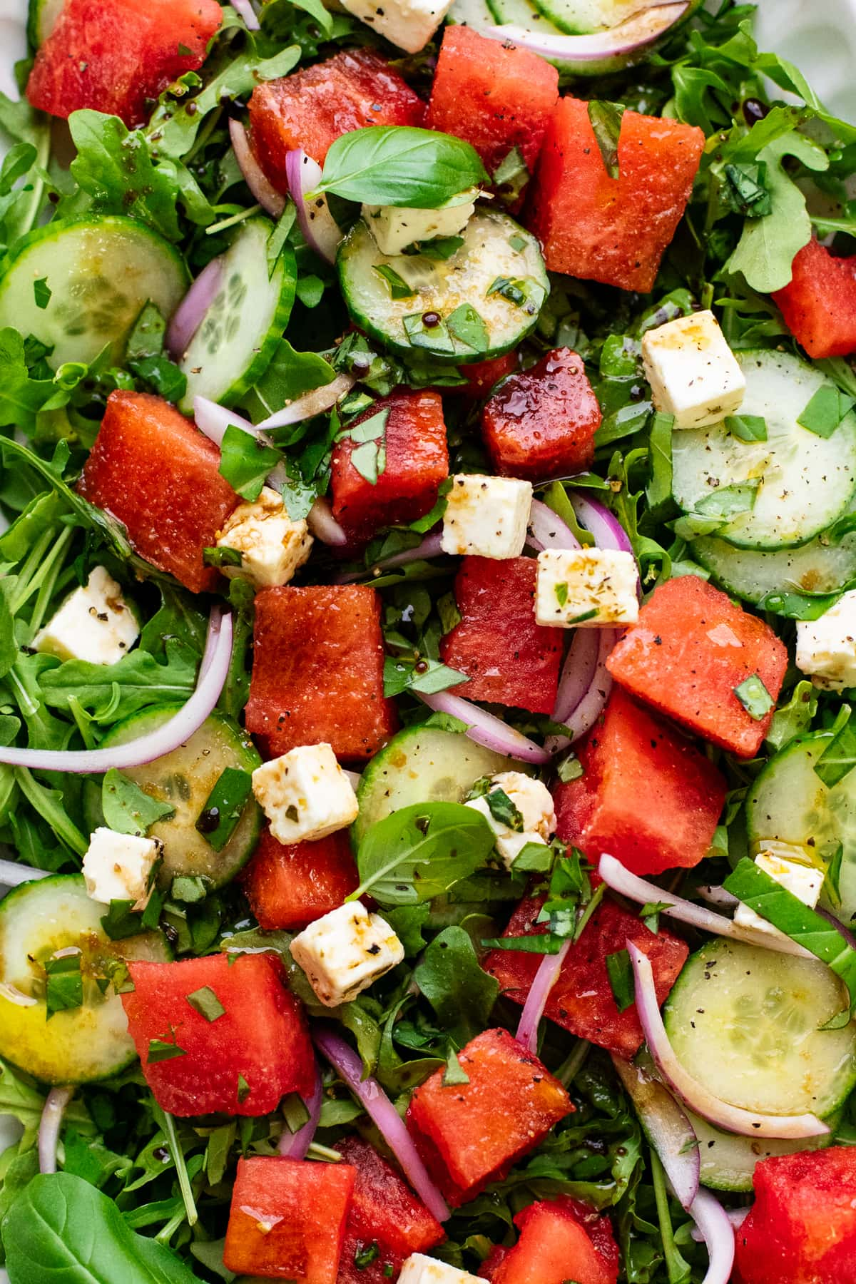watermelon salad with feta and leafy greens.