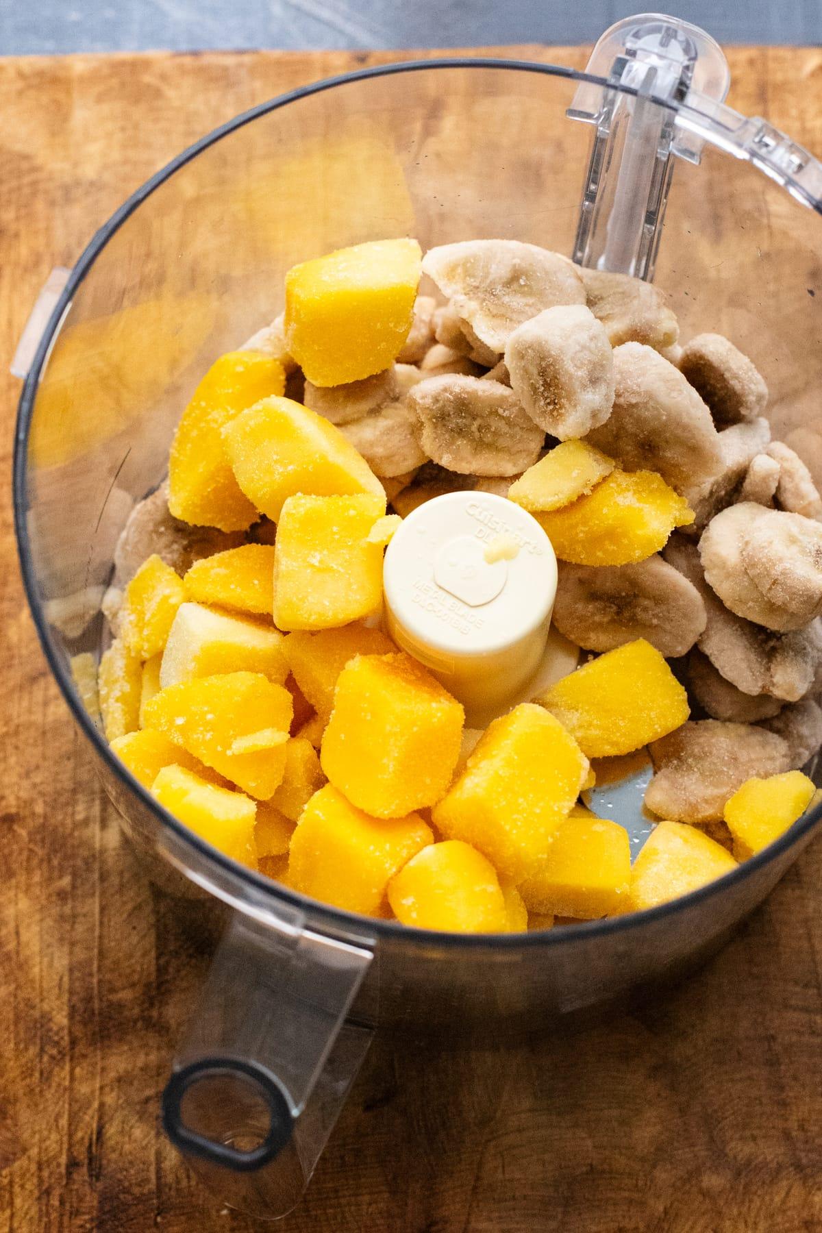ingredients for mango sorbet in food processor.